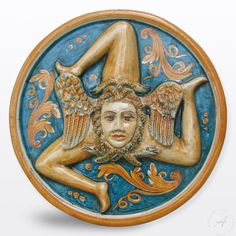 Sicilian three legged symbol Trinacria handmade ceramic pottery plaque. Mine is multi colored, but I love the complimentary colors in this gem.