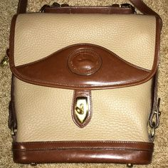"Vintage Dooney & Bourke tan pebble EUC purse Authentic DB vintage early 90's tan pebble cross body bag with gold hardware. Footed bottom. Got it in 1995 & have only carried it a handful of times so it is in great condition. Just too small for me. Smoke free home. Gorgeous classic style!!  L: approx 8 1/2""- 9 1/2"" (tapers slightly out at top), H: 10"", W: 2 1/2"". Open to offers! Dooney & Bourke Bags"