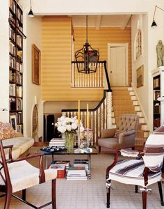 sunny sitting area, with books against the wall; Eric Cohler Design