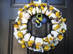 I love the bumble bee theme! diaper wreath for baby shower