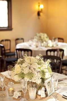 White Round Wedding Centerpieces | photography by http://stephanieasmith.com/