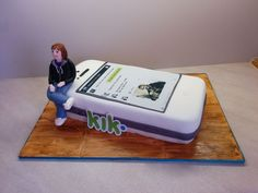 Birthday cake for my husband's friend. Its meant to be an iPhone lol. Edible image on the top. Wood is painted fondant. Not my best cake I don't think!!! The cake is to high... Phones are quite flat... But it needed to be enough to feed all the people at the company :)