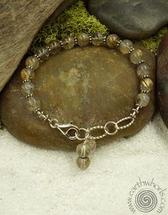https://earthwhorls.com/products/1662sb  Always, all about the stones at EarthWhorls.  Rutilated quartz and sterling silver bracelet - one of a kind - handmade - free shipping - easy online shopping.