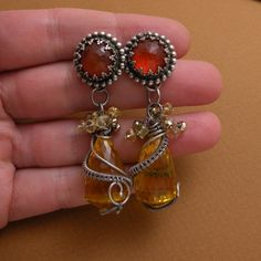 Beautiful craftsmanship.  Handmade - wire wrapped.  Click on the picture and it will take you to her etsy site.