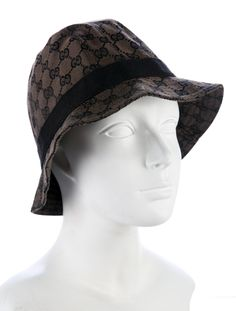 711b4e4fb64 Black and brown Gucci jacquard bucket hat featuring GG pattern throughout  and grosgrain band. Black