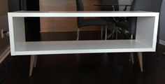 IKEA hack- you'd buy the kallax shelf and then buy the legs separate