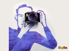 Camarógrafo con cámara de fotos particular Muy bueno...la foto saldrá del color de la tinta? juaaaa en fin muy buena combinación del dibujo con la cámara de fotos.