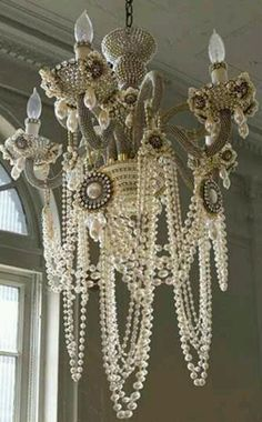 Pearl Chandelier.....high end country obviously....great idea to drape strands of inexpensive pearl garlands over a chandelier.....