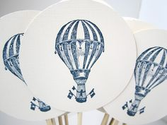 Hot air balloon cake or cupcake toppers navy blue and white circus state fair theme vintage balloon cream colored set of 50. $21.00, via Etsy.