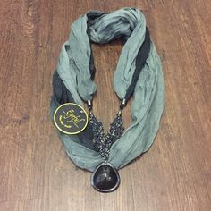 NWT Embellished Infinity Scarf Brand-new green and black scarf. Jeweled detail with black stone. Same day or next day shipping. No trades and no holds. 20% off of bundles. Eyeful Accessories Scarves & Wraps