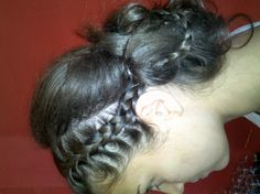 Braided updo (side view) done by one of our stylists, Anna