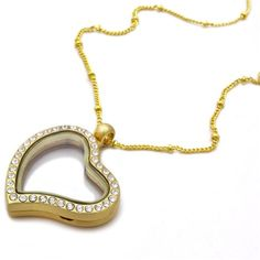 A stunning gold locket pendant necklace comprising of a heart locket finished with clear crystals Charms are sold seperately under Charms Pendant can