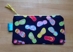 A personal favourite from my Etsy shop https://www.etsy.com/uk/listing/263626255/flipflop-small-zip-pouch-flipflop-fabric