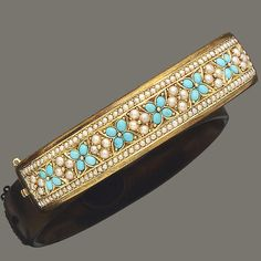 Pretty Turquoise and Pearl floral bangle bracelet set in gold.