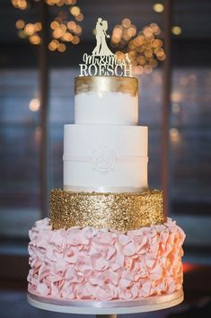 Gorgeous four tier ruffle and gold cake!