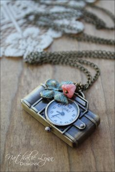 Camera Pocket Watch Necklace,  Camera Necklace, Photography Necklace, Steampunk Necklace, Watch Necklace, Pocket Watch Necklace by nathalielynndesigns on Etsy https://www.etsy.com/listing/286601853/camera-pocket-watch-necklace-camera