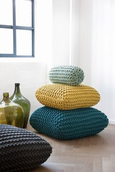 Beautiful knitted and coloured floor cushions. Available in 3 different sizes and 4 different colours. By Ferm Living.