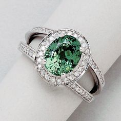 Demantoid Garnet, Diamond and 18K White Gold Ring   1 demantoid garnet weighing 3.14 cts, 51 round diamonds totalling approx 0.35 ct