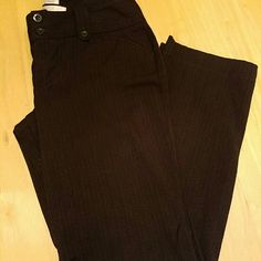 Black Pinstriped Dress Pants Old Navy Stretch black dress pants with very light pinstripes. Buttoned belt loops and back pockets with curved front pockets on sides of hips. These are adorable and very professional boot cut pants worn only a handful of times. Size 8 - true to size Old Navy Pants Boot Cut & Flare