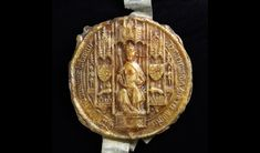 The seal shown is a Great Seal of Henry VIII (E 329/475). This, the obverse, shows Henry on his throne, complete with orb and sceptre. The seal was used on a letter from Henry to Edward Seymour, a knight, in which he granted an annuity of 50 marks.