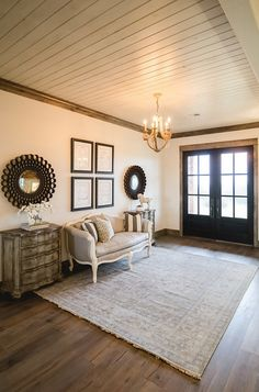 Farmhouse Foyer with tongue and groove ceiling and black front doors. | Alicia Zupan