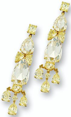 YELLOW DIAMOND PENDENT EARRINGS.        Each set with two pear-shaped rose-cut yellow diamonds altogether weighing approximately 16.95 carats, supporting a fringe of three pear-shaped diamonds, decorated by pear-, cushion-shaped and brilliant-cut yellow diamonds altogether weighing approximately 13.96 carats, mounted in 18 karat yellow gold. Sotheby's.