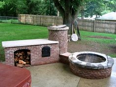 Here's a finished view of the fire pit, smoker and an addition which houses a wood storage area and what appears to be a wood fired oven!