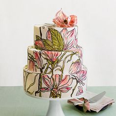 Hand-Painted Floral Wedding Cake | Showcase an iconic Southern flower with a hand-painted design that feels more like a piece of stained glass than a work of flour and sugar. Even the three-dimensional blossom on top is edible.