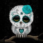 This cute design by artist Jeff Bartels features a baby snowy owl chic with large black eyes and a single rose on its head. Swirling lines and dot patterns decorate the small white owl in the tradition of Day of the Dead sugar skulls. The bird is sitting on a branch with a star filled night sky visible in the background. The over sized head and small body along with the details in the furry feathers create a beautiful combination of a cartoon and realistic look. This unique and adorable Day…