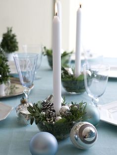 Candlestick Centerpiece -- Festive candleholders are created by placing low votives in a glass bowl. Fill in around votive with cones, pods and clippings of evergreen. Make several to go down the center of the table or to dress up the bar. Scatter around glass ornaments for extra sparkle.
