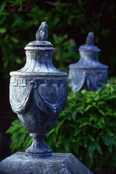 Two garden lead urns at Tapeley Park. These 18th-century Italianate gardens were laid out by Lady Rosamund Christie, and much of the planting was done by her granddaughter, another Rosamund Christie. England, ca. 1960-1994. Image and text credit:  corbisimages.com