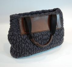 I love this bag! You buy the yarn and leather components, and they give you the pattern for free.