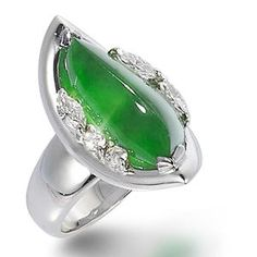 A jadeite and diamond teardrop ring.  The ring of a semi-translucent intense green curved jadeite plaque, with diamonds.