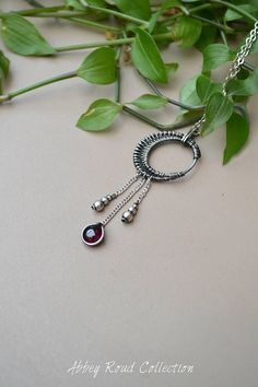 Antique Silver Garnet Moon Pendant. Wire Wrapped Moon Pendant.