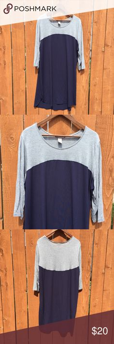 H&M+ raglan tee dress 3/4 sleeve XL Grey jersey on top, navy on bottom - it's a different texture fabric, more like chiffon but still stretchy (the entire dress has stretch). Hi low hem. Gently used. Approximate flat measurements: chest 25in, length 37in. Size is XL but I'm listing as 0X because it is H&M's plus line and larger than the regular line's XL. H&M Dresses