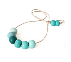 Bright Turquoise Blue Long Chunky Necklace for women, handmade colourful jewelry by Lottie Of London