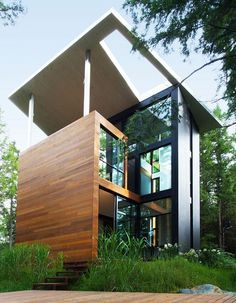 Modern house in the woods for Polish Sculptor Jacek Jarnuszkiewicz