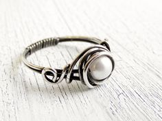 Antiqued Sterling Silver Pearl Ring Wire Wrapped Ring. $22.00, via Etsy.