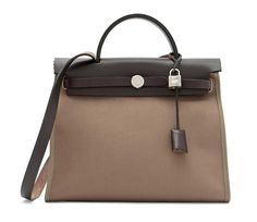 An etoupe toile officier and ebene hunter leather herbag zip