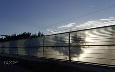 The shadows of the trees on the noise barrier at the tram line Name Boards, Line, Shadows, Trees, Explore, Sunset, Darkness, Fishing Line, Tree Structure