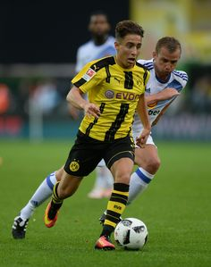 Emre Mor of Dortmund (l) challenges Lee Cattermole of Sunderland during the friendly match between AFC Sunderland v Borussia Dortmund at Cashpoint Arena on August 5, 2016 in Altach, Austria.