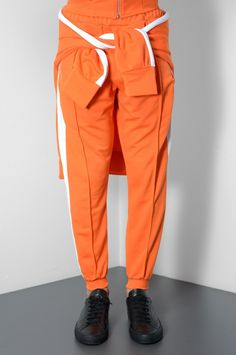 CHRISTOPHER SHANNON ORANGE TRACK TROUSERS