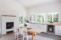 Architect Sheila Narusawa came to this project when her high school boyfriend (whom she hadn't seen in decades) was looking to build a house. She ended up marrying him—and designing a New England-inspired, modernist hideaway for the two of them, shiplap-paneled kitchen included. Look closely: It's filled with a career's worth of clever, cost-conscious design solutions.
