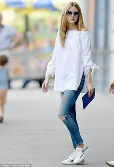 Stylish lady: Olivia Palermo  wore an off-the-shoulder white blouse by TIBI with ripped denim, showing off her toned legs in Brooklyn on Friday
