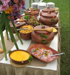 hot foods displayed in matching crockery.  great for a rustic reception, or a wintertime dinner