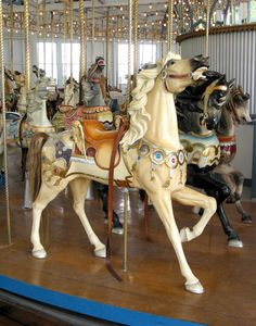 These horses are beautiful.  As carousels go, the interior is remarkably plain so it must be a modern merry-go-round, though the horses may be old.  No info.