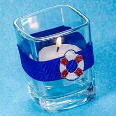 Our DIY Nautical Cruise Square Votive Holder is the best of our handmade party favors.