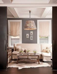Cow Hide Rug; Dark gray and cream living room    http://www.cuphalffull-sf.blogspot.com/#