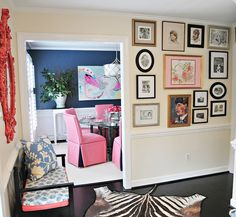 gallery wall, pink dining chairs, navy dining room, great color flow