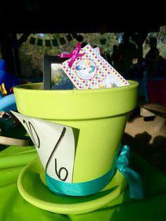 Center pieces  Mad hatter hats  Graces Onederland birthday  Alice in wonderland inspired  First birthday  One